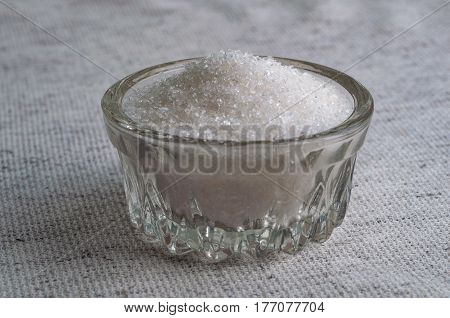 Bowl of white sugar. white granulated and refined sugar