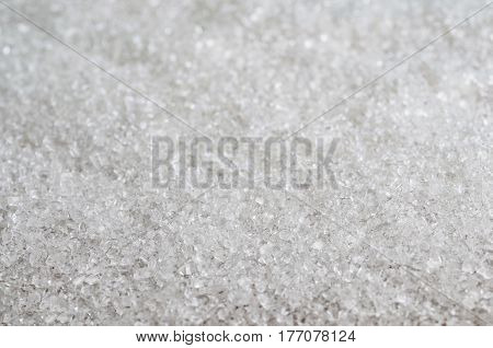 white sugar background closeup. Abstract background with granulated white sugar.