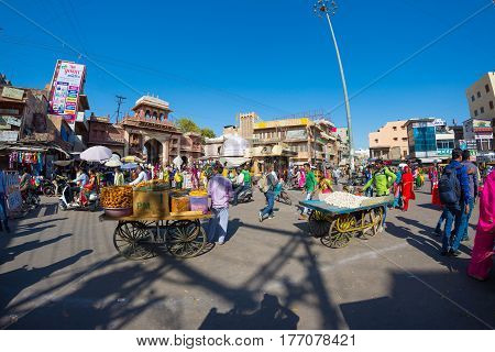 Jodhpur India - February 24 2017: crowd market and food stalls in Jodhpur famous travel destination in Rajasthan India.