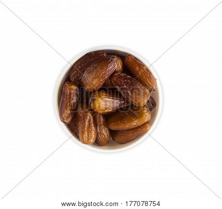 Date fruit in a wooden bowl. Dried fruit with copy space for text. Top view. Date fruit isolated on white background.