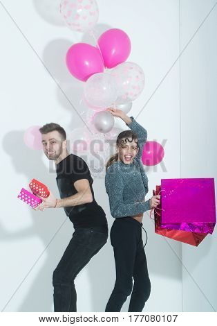 Happy Couple Of Pretty Girl And Man Smiling With Balloons