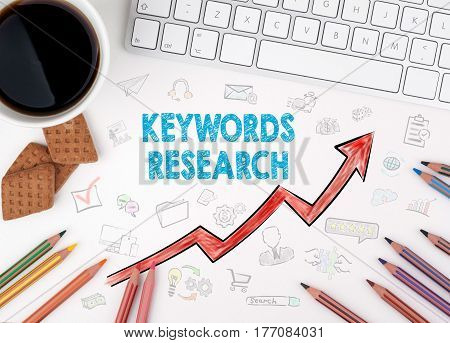 Keywords Research Business Concept. White office desk.