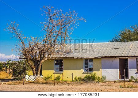 Old Abandoned Home With Broken Windows & Open Doors