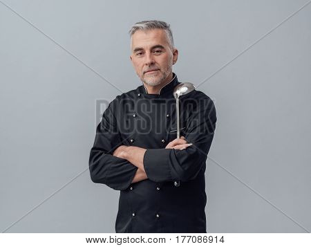Chef Posing With A Spoon Ladle