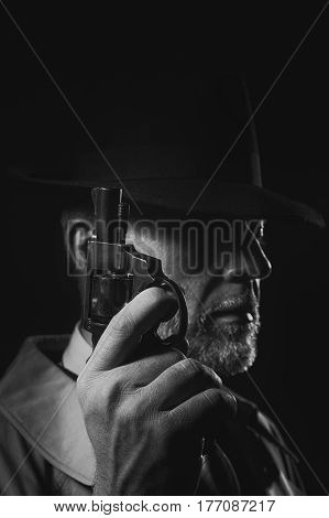 Detective Holding A Gun In The Dark