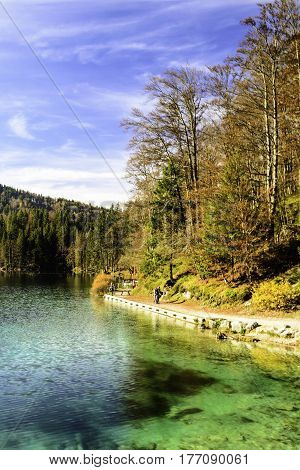 sunny autumn day at the alpine lake