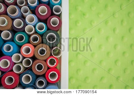 Set of colorful spools of thread in a table