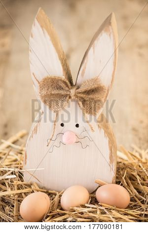 DIY handmade wooden easter bunny with easter eggs
