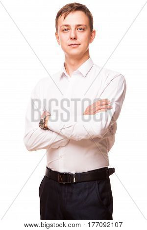 Young handsome businessman in white shirt is standing straight and crossing his hands, portrait isolated on white background.