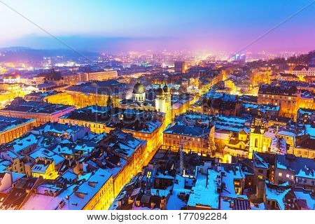 Scenic winter night snowy aerial view of the Old Town architecture in Lviv, Ukraine
