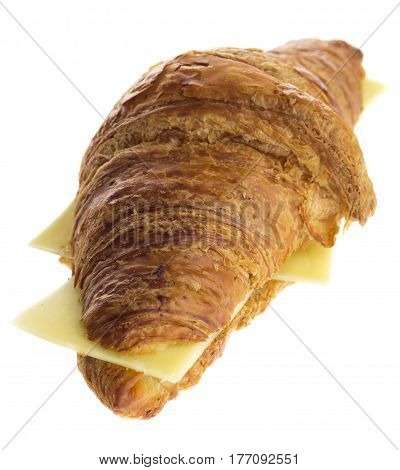 French croissant with dutch cheese isolated on a white background