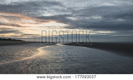 Stunning Colorful Winter Sunrise Over Low Tide Beach
