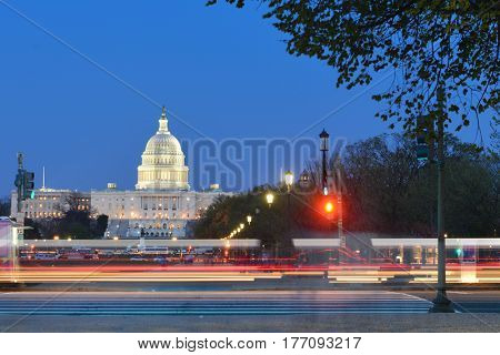 Washington DC at night - US Capitol Building with car lights trails foreground