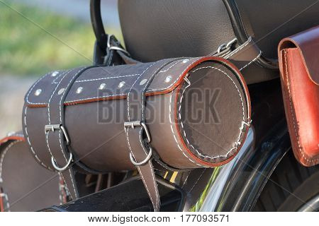 Leather equipment on a motorcycle closeup. Life style