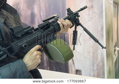 Machine gun in the hands of a man. Weapons