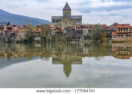 View of Svetitskhoveli cathedral over Mtkvari (Kura) river at early springtime