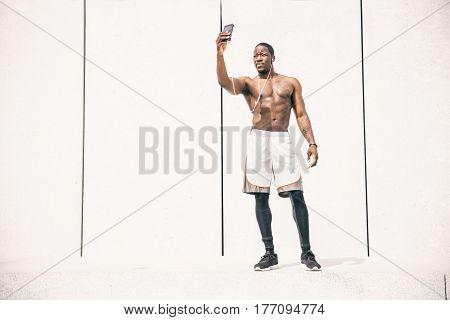 Sportive man training outdoor taking a selfie