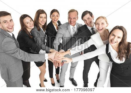 Concept of teamwork. Business people team joined hands, isolated on white background