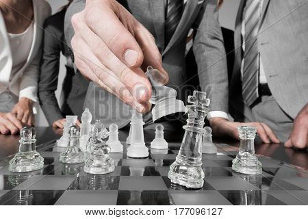 Business people team playing chess, business strategy concept