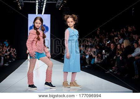 MOSCOW RUSSIA - MARCH 12 2017: Model walk runway for L'EREDE catwalk at Fall-Winter 2017-2018 at Mercedes-Benz Fashion Week Russia. Kid's fashion.