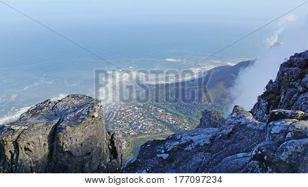 View through the rocks from the Table Mountain on Cape Town and the Atlantic