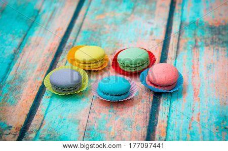 Macaroon Cookies On Blue Wooden Table