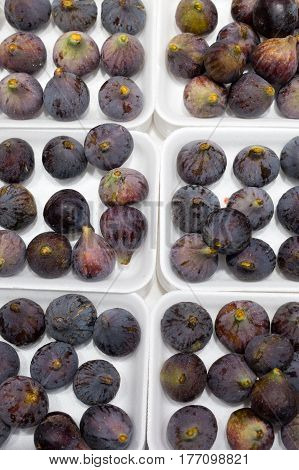 Background from fresh ripe figs on a white substrate