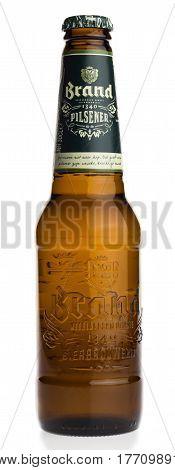 GRONINGEN, NETHERLANDS - MARCH 19, 2017: Bottle of Dutch Brand Pilsener beer isolated on a white background