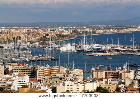 View of the port with yachts and the city of Palma De Mallorca