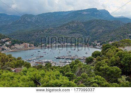 Port with yachts in the bay in the mountain