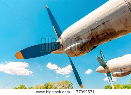 Turbines of turboprop aircraft against blue sky at an abandoned aerodrome