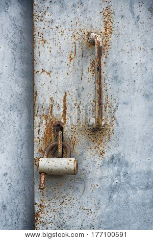Wooden door surface with padlock abstract background. The effect of two layers