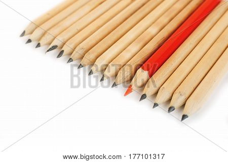 Row of rough graphite pencils with color red one as a symbol of difference and opposition