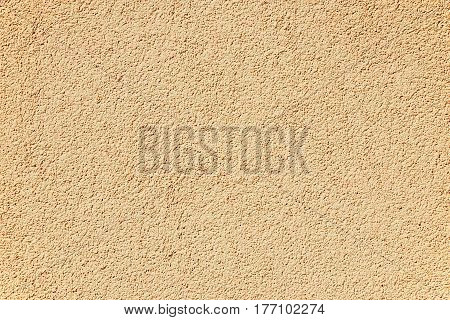 Fragment of a wall covered with gravel modern stucco