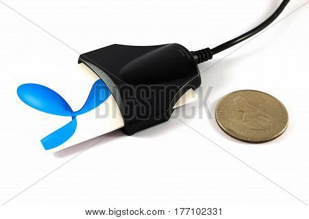 Card reader with card and one dollar coin isolated on white background