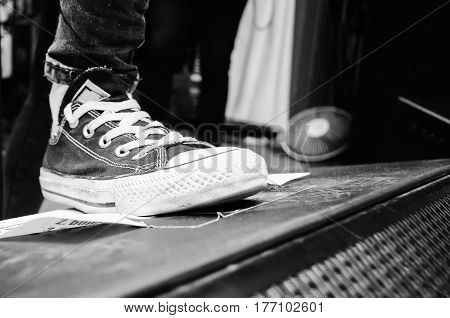 Classic black and white sneakers shoe musician girls at the rock festival concert on stage