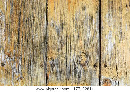 Yellow painted scratched and threadbare wooden plank texture