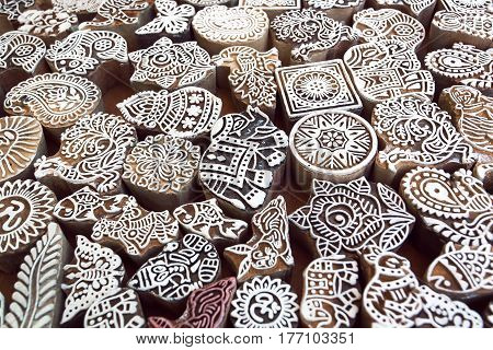 Patterns elephant and other symbols on wooden surface of mold blocks for traditional printing textile. Popular design in India