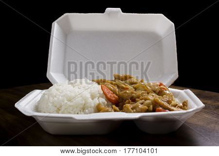 Closeup of a Chinese stir-fry meal with vegetables, chicken and rise