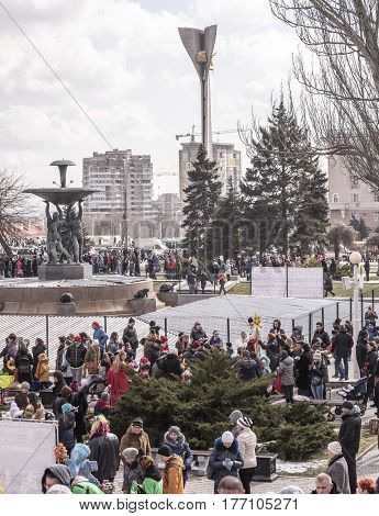 Rostov-on-DonRussia - February 26 2017: Maslenitsa- Adults and children walk in the park to Shrovetide