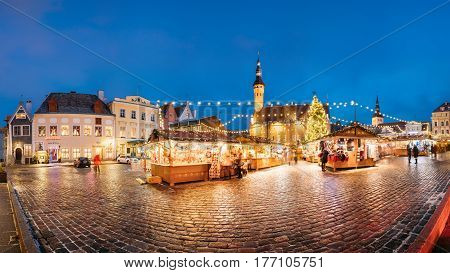 Tallinn, Estonia - December 2, 2016: Famous Traditional Christmas Market On Town Hall Square - Raekoja Plats. Christmas Tree And Trading Houses With Sale Of Christmas Gifts, Sweets And Mulled Wine.