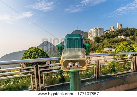 Hong Kong, China - December 7, 2016: Tourist binocular at free viewing terrace of Victoria Peak Galleria, a grand shopping center near the Peak Tower the island's highest viewing platform.