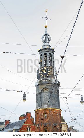 Ancient architecture of Amsterdam. View of the Historical tower Munttoren on Mint square close up. Netherlands. Vertical Image