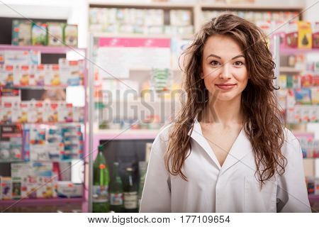 Pharmacist In Front Of Her Desk At Work