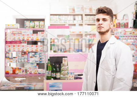 Pharmacist Man In Front Of His Desk At Work