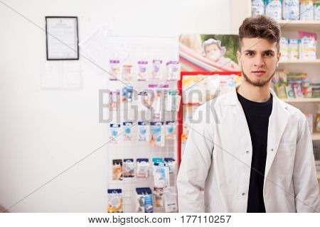 Pharmacist Man At Work Looking In Camera