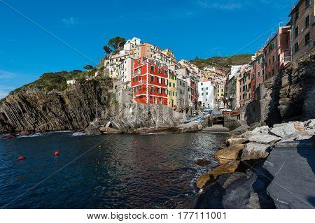 View of the architecture of Riomaggiore town. Riomaggiore is one of the most towns in Cinque Terre National park, Italy