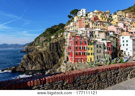 View of the architecture of Riomaggiore town. Riomaggiore is one of the most popular town in Cinque Terre National park, Italy