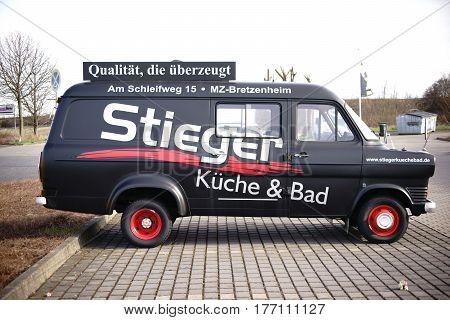 MAINZ, GERMANY - MARCH 10: The side view of an old Ford caravan for the advertising of kitchens and baths sales of the company Stieger on the March 10 2017 in Mainz.
