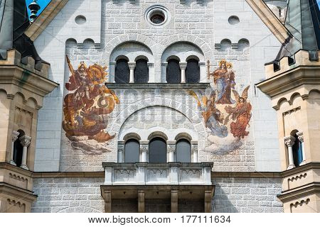 Hohenschwangau, Germany - June 6, 2016: The Patrona Bavariae and Saint George on the court face of the Palas. Main building. Neuschwanstein Castle, Bavaria, Germany.